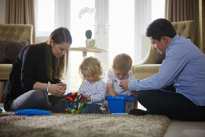 Family playing with toys in Taylor Wimpey home