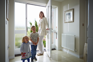 Family viewing new Taylor Wimpey home