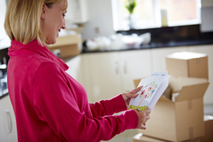Woman opening moving in card