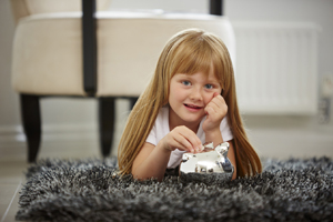 Little girl lying on a rug