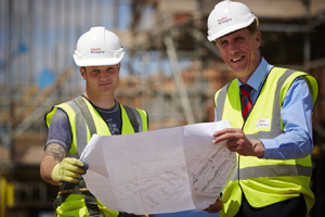 Taylor Wimpey site manager with layout plans