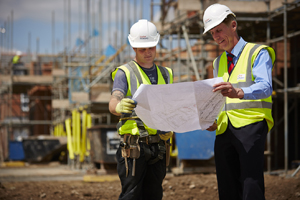 Taylor Wimpey site team studying layout drawings