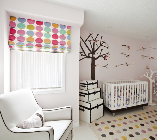 Nursery with wall mural and spotted blind