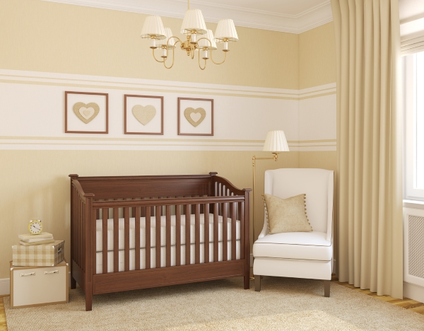Taupe nursery with wooden cot and heart theme