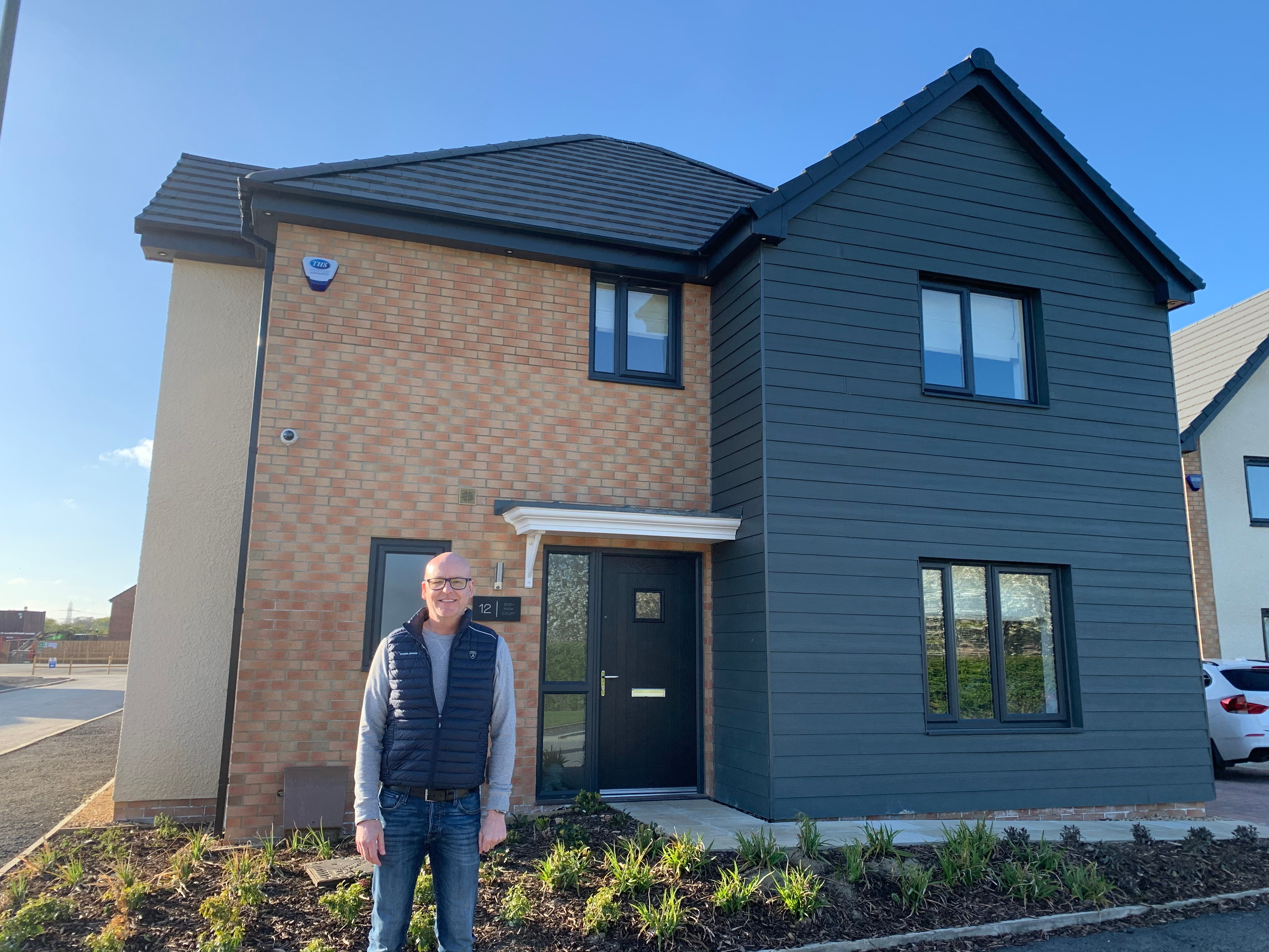 Paul Nowlin outisde his new Taylor Wimpey Home at Kenton Bank Mill Kingston Park