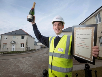 EX  Trainee Assistant Site Manager Darren Hall celebrates winning the Taylor