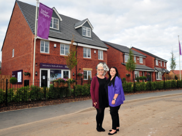 NEWS  TWMan  Wiganborn twin sisters Emma and Katie Edwards have always been close  and Taylor Wimpey