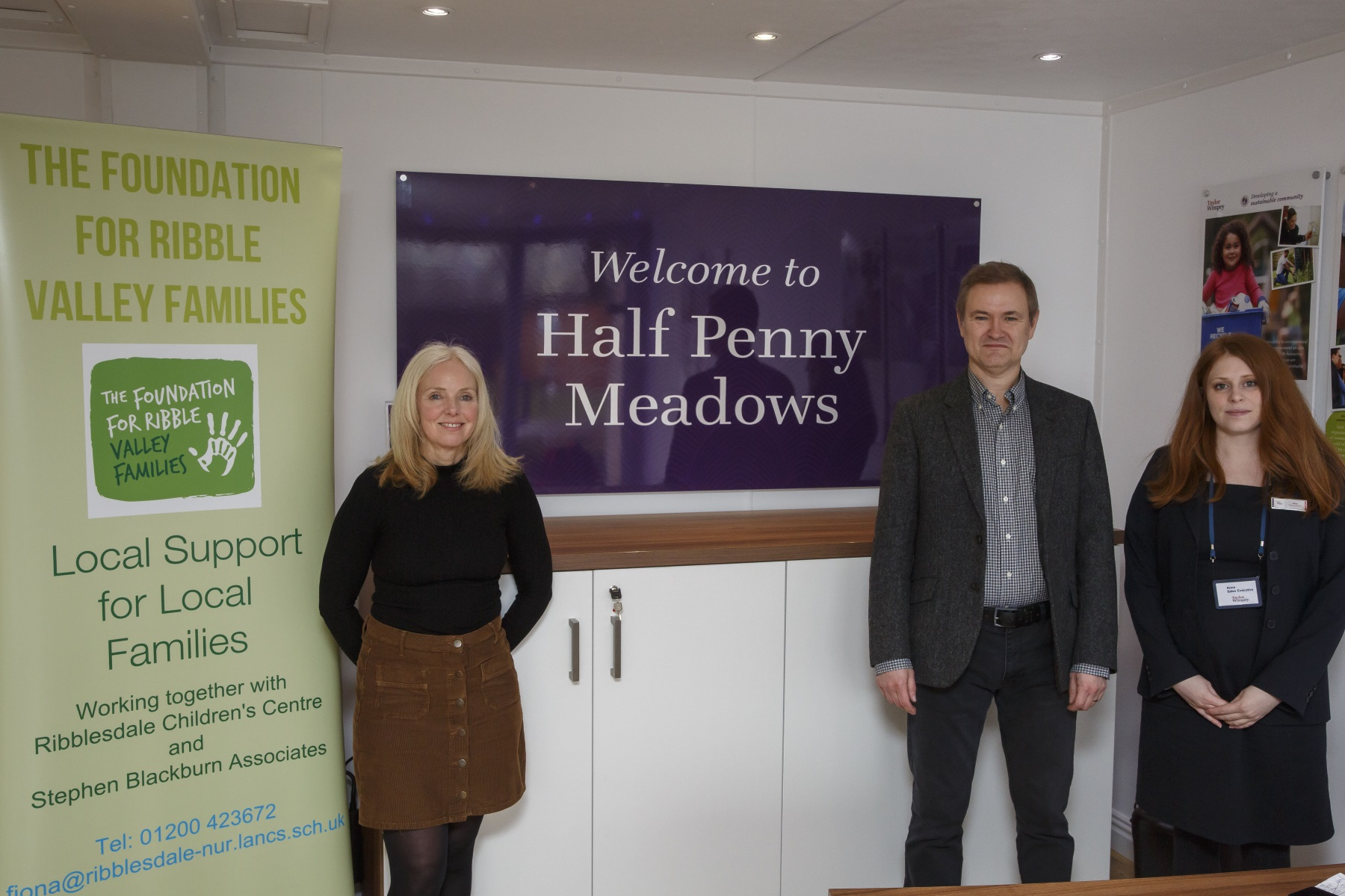 Fiona Maudsley and Steven Blackburn with a Taylor Wimpey sales exec