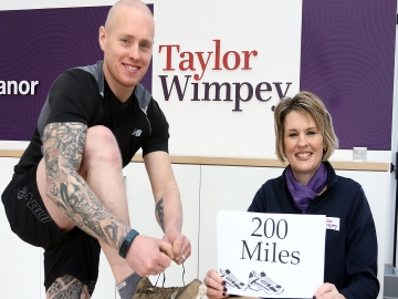 NY Matthew McNamara with Taylor Wimpey sales executive Annabelle Knaggs - WEB
