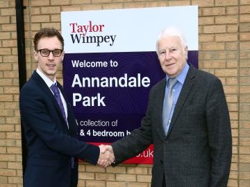 WEB Ryan Porteous Taylor Wimpey sales executive with Ian Johnson chairman