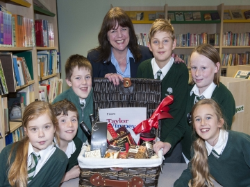 Taylor Wimpey Sales Executive Sandra Watson with pupils from Holland Jun - Website