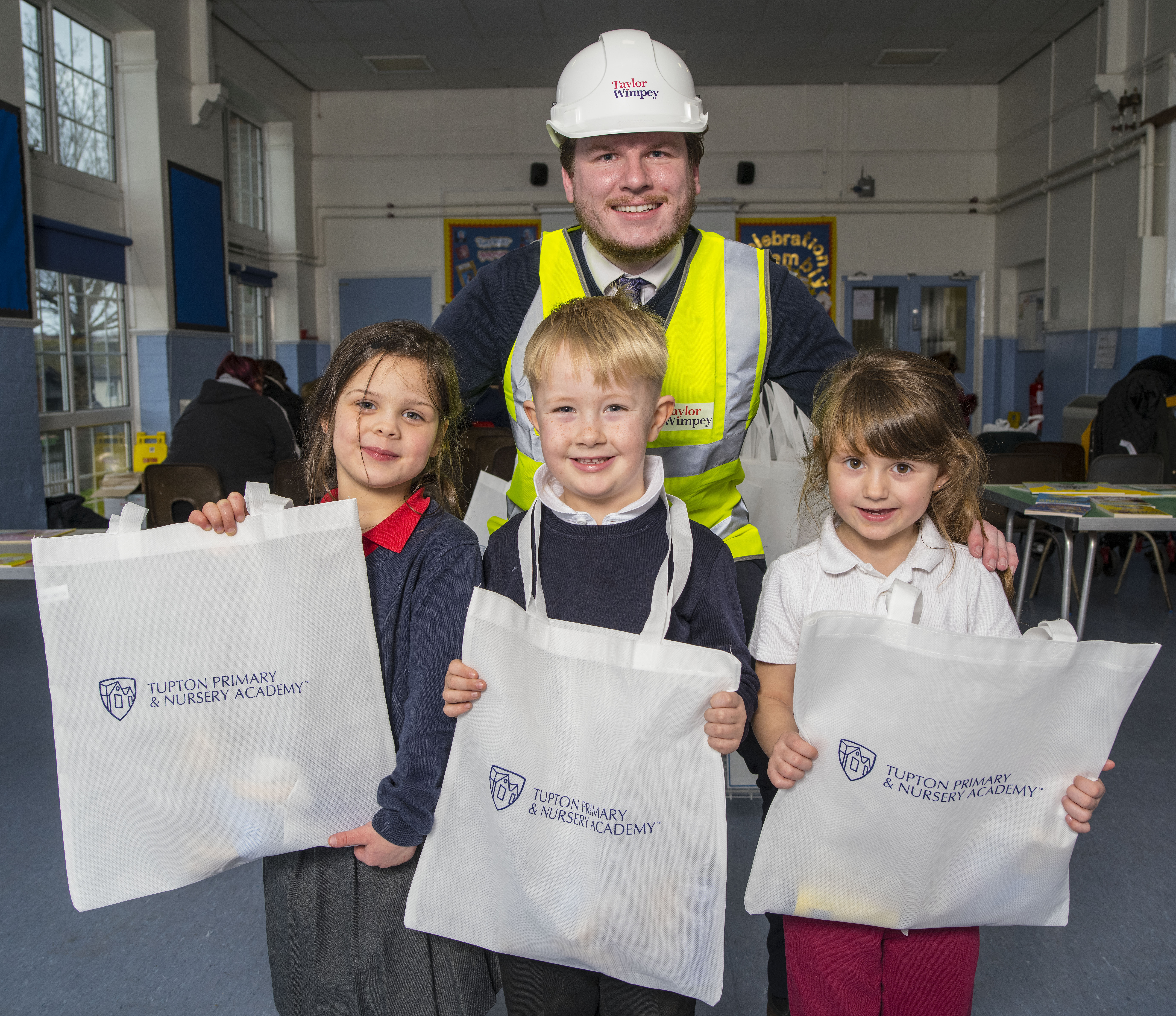 Taylor Wimpeys Edward Wragg with children from Tupton Primary