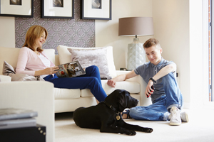 Couple with dog in lounge