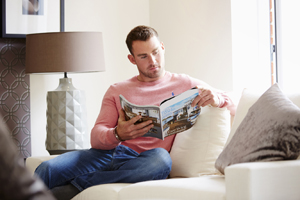 Man looking through magazine
