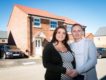 WEB - Paige Case and Steven Carr outside their new Taylor Wimpey home
