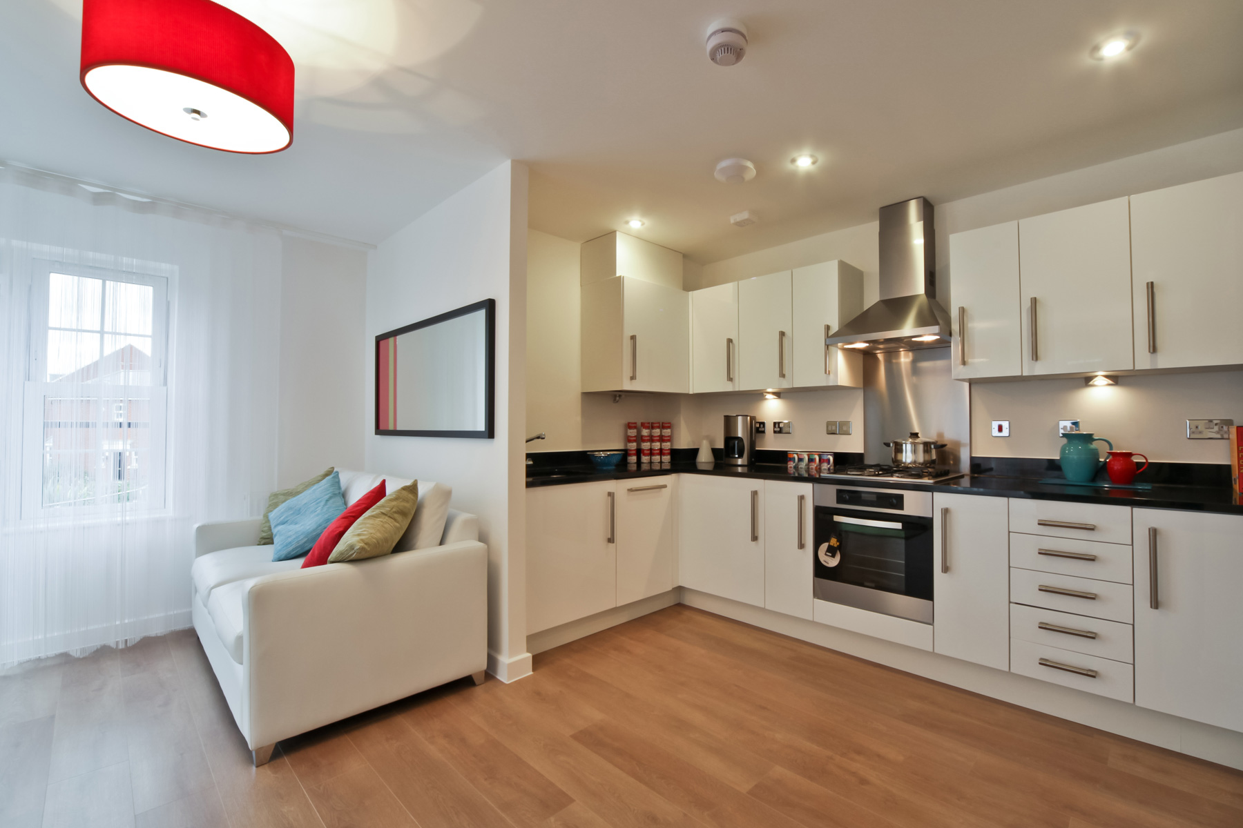 Typical Taylor Wimpey apartment kitchen and sofa.