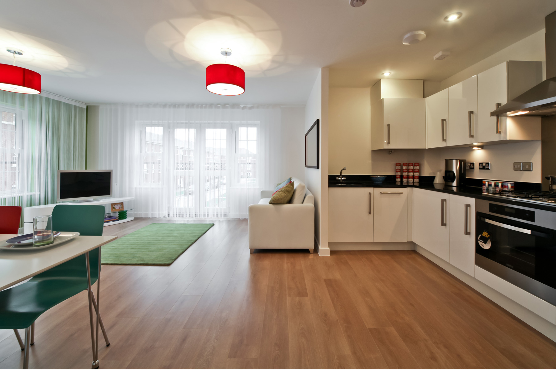 Typical Taylor Wimpey apartment living area and kitchen.
