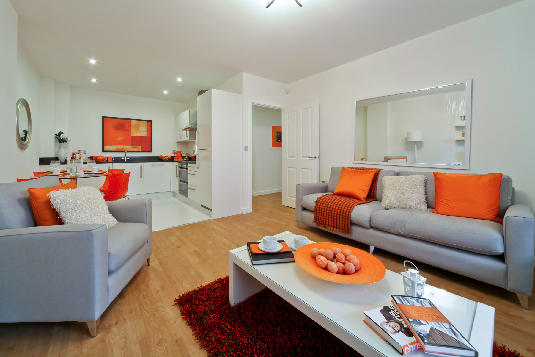 A typical Taylor Wimpey apartment living area and kitchen.