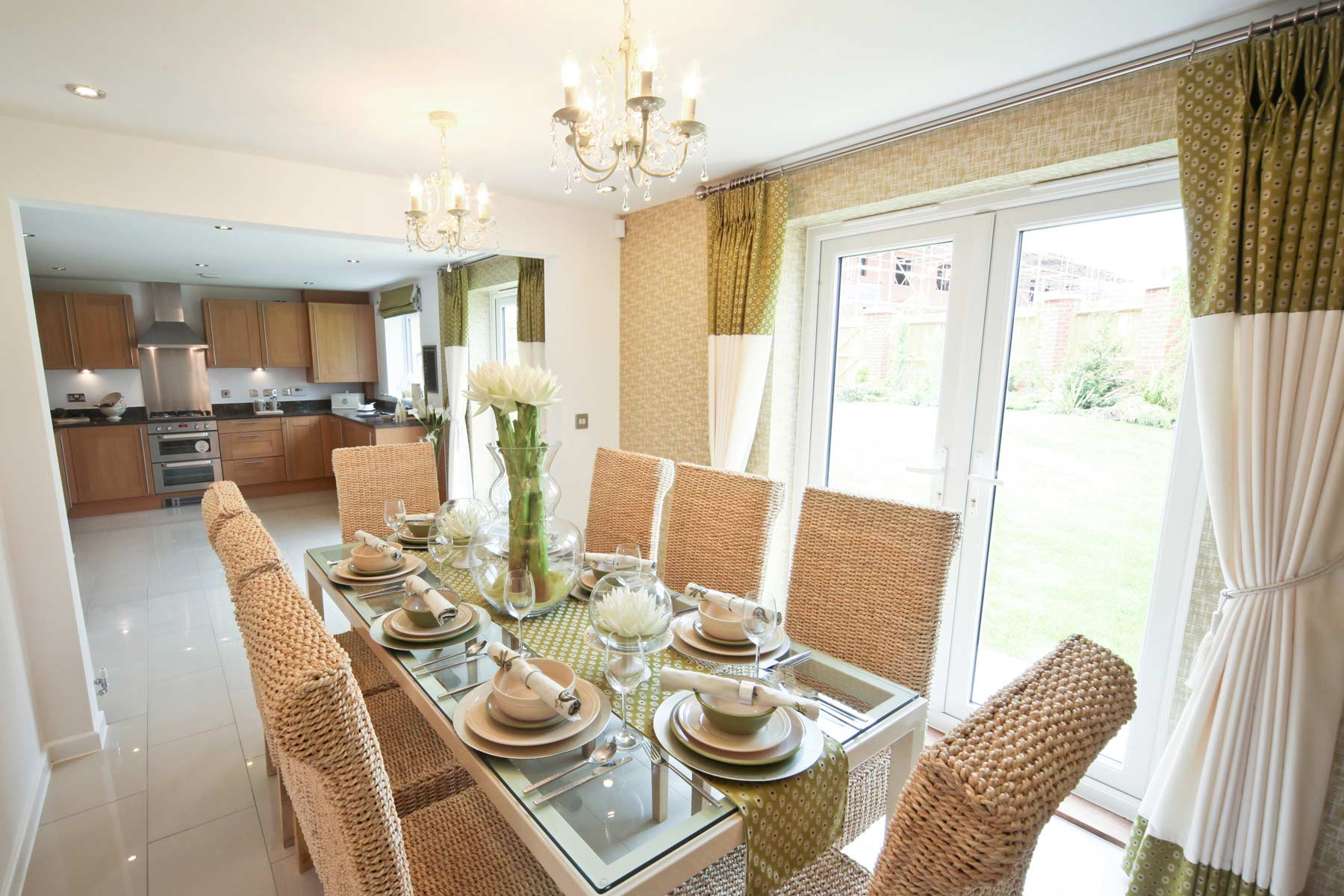 A typical Taylor Wimpey dining room and kitchen.
