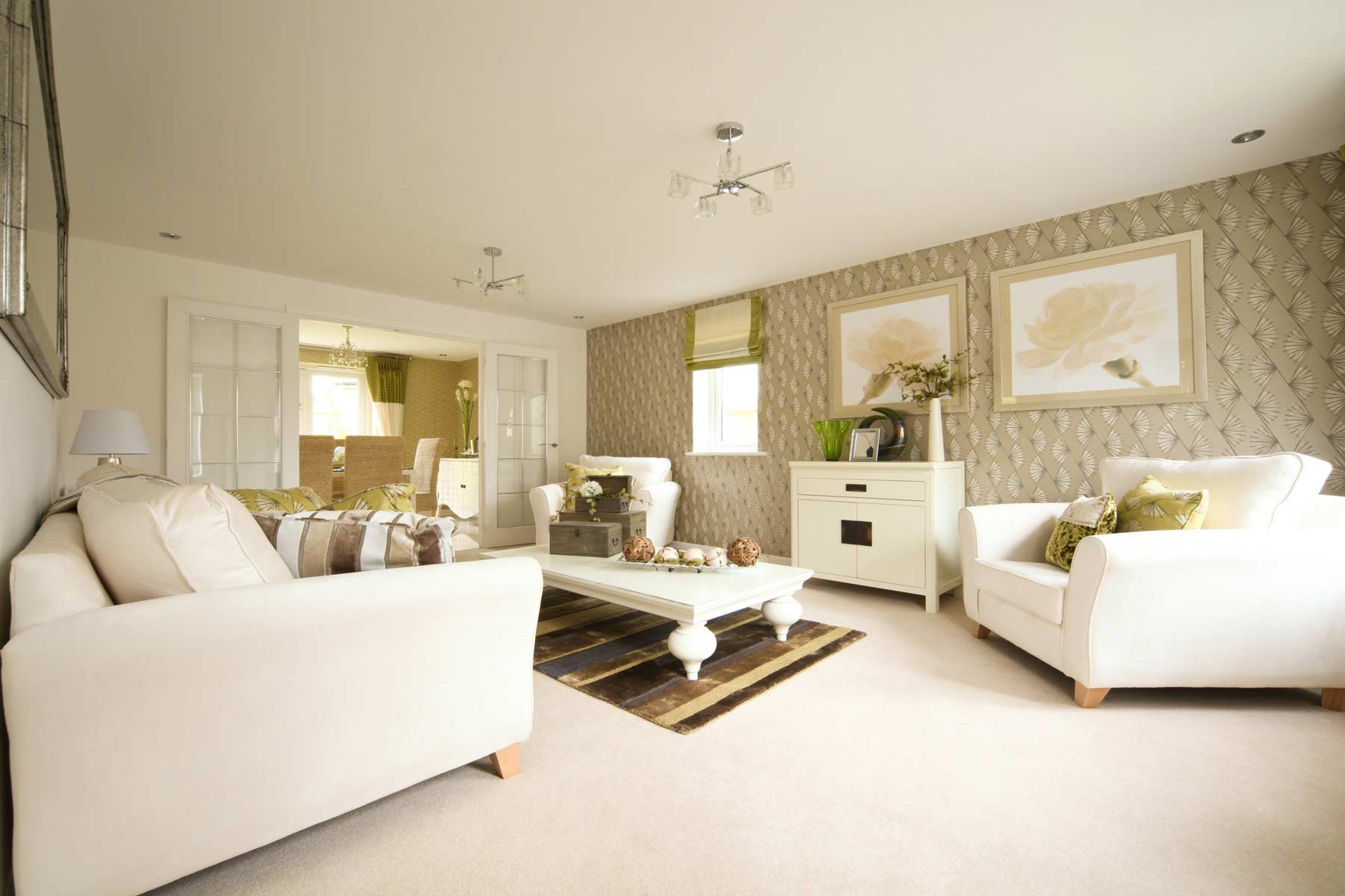 A typical Taylor Wimpey living room through to dining room.