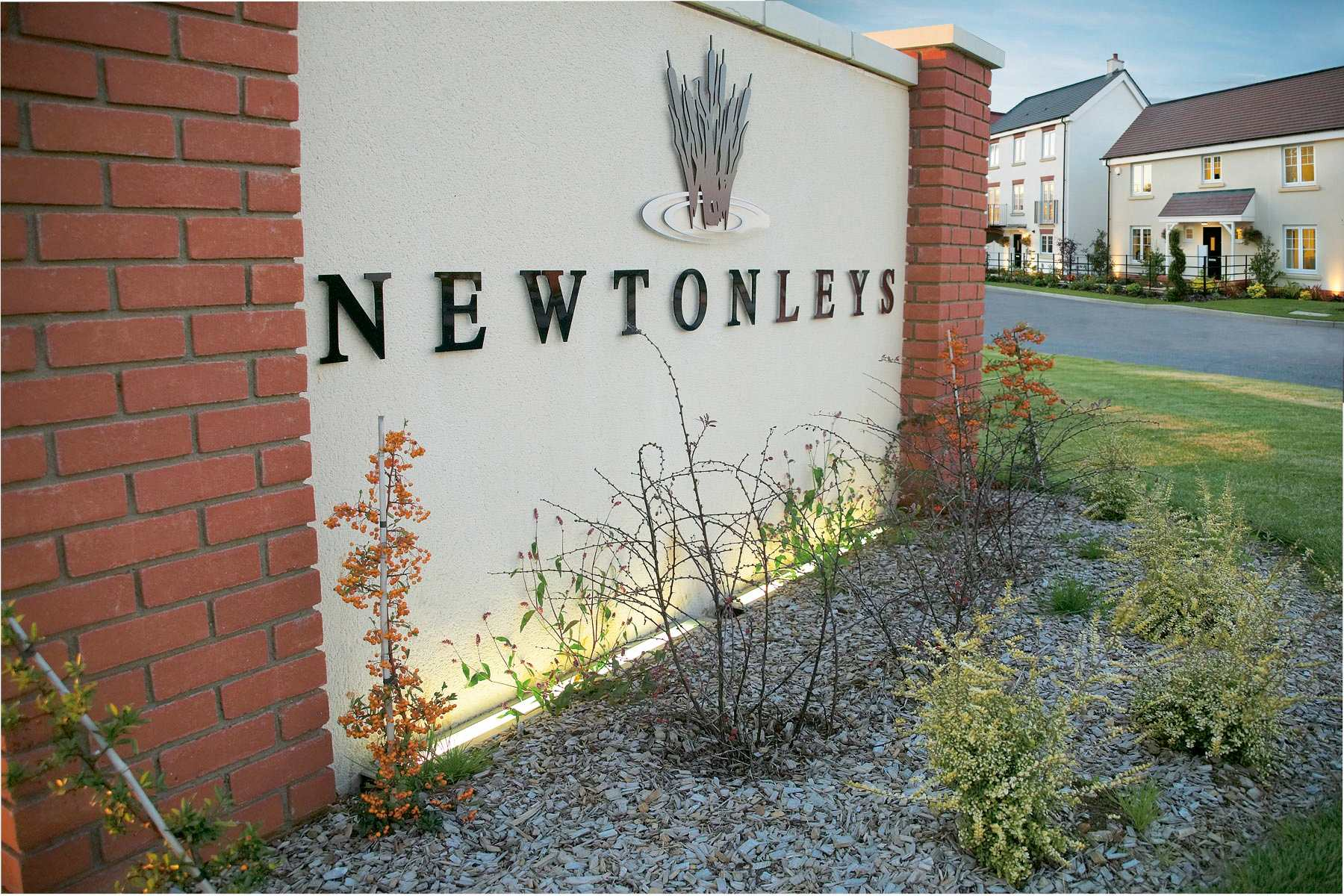 Photo of the sign marking the entrance to Newton Leys